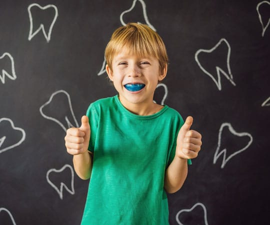 Alt tag: Get extra protection during sports by using mouthguard, Contact Bellevue Azalea Dentistry today.