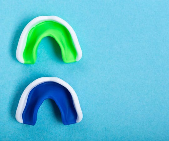 Get custom made mouthguard at Bellevue Azalea dentistry to reduce your chances of dental injuries